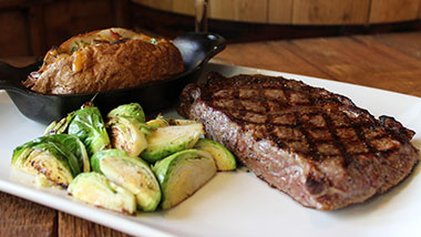 Steak, brussel sprouts, and baked potato at Journy steakhouse at Argosy Casino Alton.