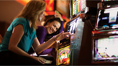 ladies playing slot machines