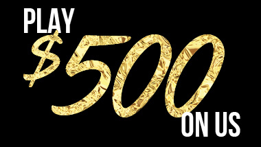 "The words ""Play $500 on Us"" in white and gold on a black background."