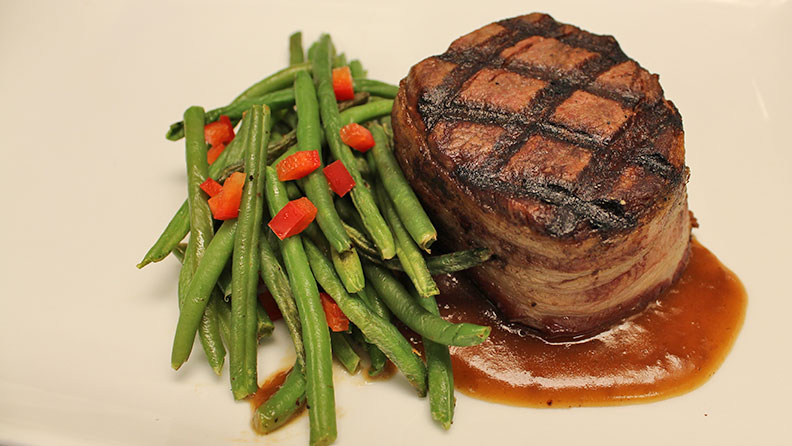 Steak filet and green beans at Journey at Argosy Casino Alton.